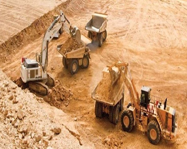 Excavator, Loader and Dump Trucks on mine site